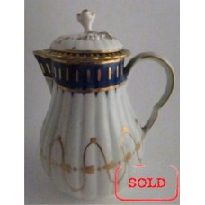 SOLD Worcester Pear Shaped Milk Jug and Cover, moulded fluted body, shallow domed cover with flower finial. Decorated in underglaze cobalt blue and rich gilding, c1775 SOLD